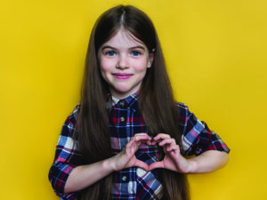 Child making heart sign