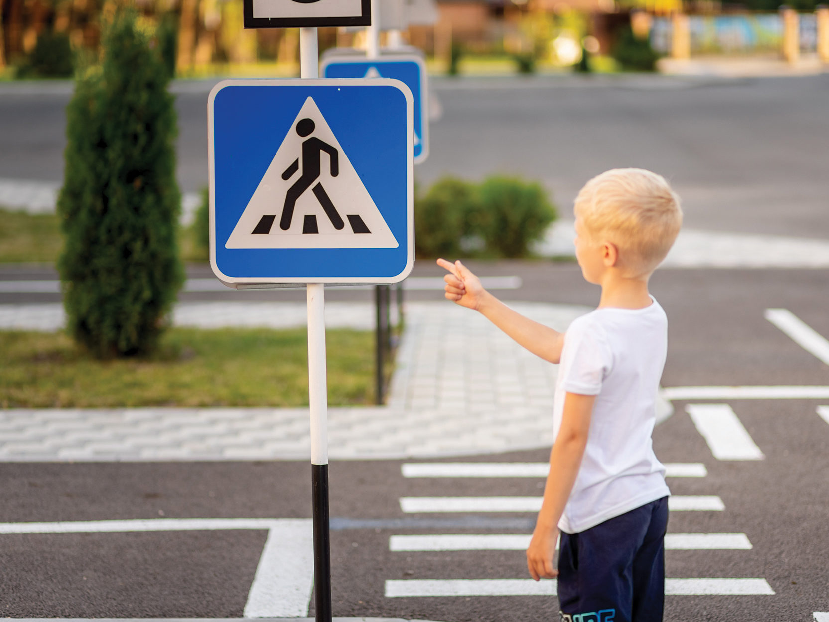 Child pointing at sign