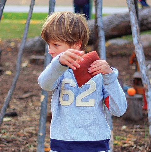 Child tossing beanbag