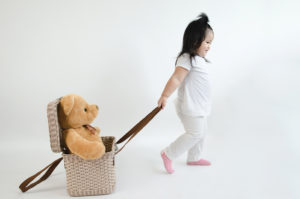 child pulling basket