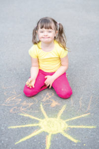 Child with chalk drawing