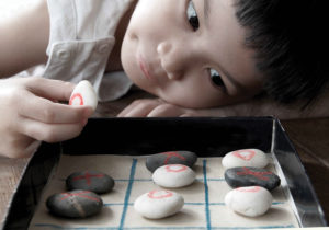 Child playing tic tac toe