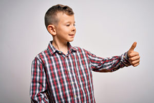 Child giving a thumb's up signal