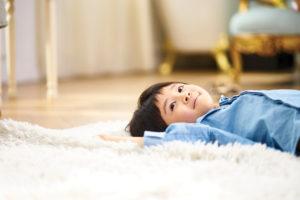 Child lying on its back