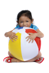 Child holding beachball