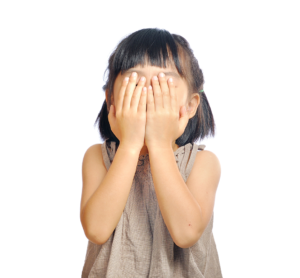 Child covering their eyes