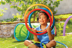 Child with colored hoops