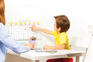 Child pointing on calendar