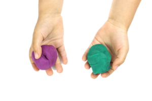 two balls of different colored play dough