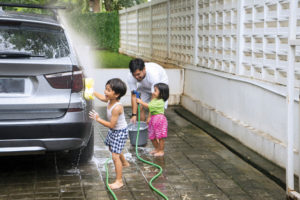 Children helping wash car
